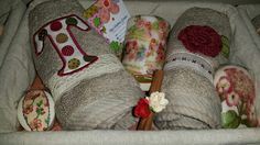 Handmade designed towels with a decoupage candle and soaps in a basket