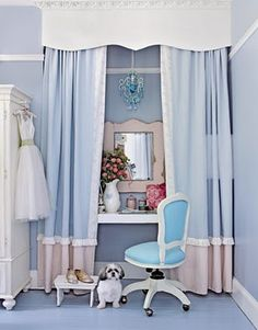 Powder blue power station framed in curtains