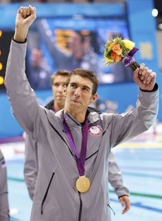 Michael Phelps of the U.S. celebrates with his gold medal after winning the men's 4x100m medley relay final during the London 2012 Olympic Games at the Aquatics Centre August 4, 2012. Phelps ended his incredible Olympic career on the perfect note on Saturday, winning his 18th gold medal for the United States in the men's medley relay, the last time he will swim a competitive race