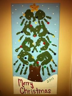 Christmas tree made with handprints of family members.  Make it a little more rustic, maybe on a piece of wood, and add a ribbon to hang it from and it might not be a bad door decoration at Christmas... by ammieiscool