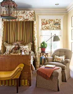 """Appropriate for boys ~a Cowtan & Tout animal fabric featuring giraffes canopies the bed and shades the window. A mustard leather saddle bench by Edward Ferrell is parked at the foot of the bed. """"Wool Trensa"""" carpet in dark brown is from Patterson Flynn and Martin."""