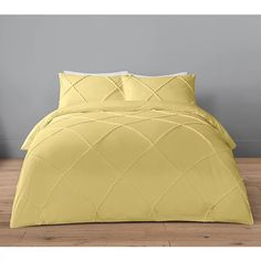 Put a luxurious spin on bedding with this tufted duvet set from George Home. Designed in bright yellow, it boasts a textured finish and is made from pure cotton offering a super-soft addition to your bedroom.
