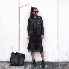 Wear a leather jacket over a sheer dress for contrast.