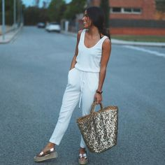 @ninauc representing white jumpsuit and sequin beach bag