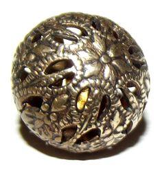 Antique Button cricket cage. Measures 9/16.
