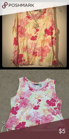 Jamaica Bay Top A tropical woman's top. Has a very Hawaiian feel to it. A tad bit short; the length from the top to bottom lying on the ground is 19 inches. Lightly used, but no defects. Made of 60% cotton, 40% rayon. Jamaica Bay Tops Tees - Short Sleeve