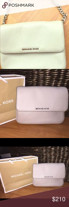 Perfect condition MK bag. Beige Michael Kors bag with no stains at all, long leather shoulder strap with silver detail. Worn 3 times. Has 4 compartments for phone, cards, makeup. Michael Kors Bags Crossbody Bags