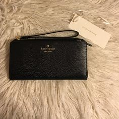"""REDUCED! KS Grand Street Layton Kate spade wristlet """"Grand Street Layton"""" NWT.  - dimensions: 4""""H x 6.5""""W - Features:  Wristlet with zip closure  Exterior zipper pocket  Let me know if you have any questions. Ships in original packaging. No dust bag included. Yes, Authentic.  Find me on Ⓜ️ercari for better deals! PRICE FIRM as I have reduced to my absolute lowest kate spade Bags Wallets"""