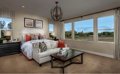 A luxurious master suite offers the ideal retreat with a spa-like bath complete with dual vanities, an oval soaking tub, an oversized shower with built-in seat and a spacious walk-in closet. - Residence Three at Autumn Crossing in Rocklin, CA
