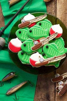 These simple fishing cookies are sugar cookies decorated with royal icing and are fun for any guy in your life weather he is three or one hundred and three.