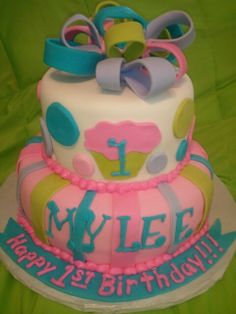 Made by LaKeisha Keck with Sweet Tooth Mother and Daughter cakes . Cupcake 1st birthday cake.