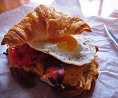 breakfast sandwich with crossiant, fried egg, and hash browns.... yummmmmm i love breakfast!