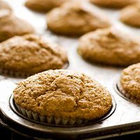 Healthy baking ingredient swaps ~ Morning Glory Muffins  Nutrition analysis per serving (1 muffin): 175 calories, 7 g total fat (0.5 g saturated fat, 0 g trans fat, 4 g monounsaturated fat), 0 mg cholesterol, 163 mg sodium, 25 g total carbohydrate (2 g dietary fiber, 8 g sugars), 3 g protein