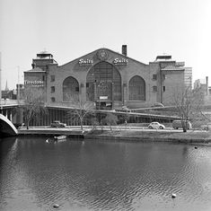 "Central Market Hall in 1965. The photographer Lennart af Petersens standing on Kungsholmen side of Clear lake and looking east towards Blekholmen. On the left King Bridge to the right glimpsed Mercedes Benz nameplate at Vasa Hall, today changed to ""Nordic Light Hotel""."