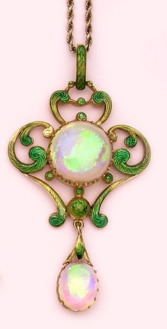 Art Nouveau - Opal, enamel and gold necklace.  Mrs. Newman, London.  Mrs. Newman was the first woman allowed into the Jewellers Guild in London. She had a wonderful store in London. Her jewelry is quite rare and beautiful in the Arts and Crafts style.