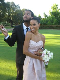 Jurnee Smollett and husband Josiah at the wedding of her sister Jazz.
