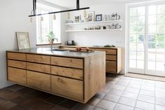 ......And for something completely different. Very similar to the way dove tale drawer boxes are created, these bespoke kitchens integrate the 'finger joints' of the drawer box into the design of the...