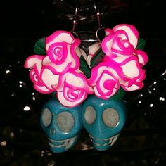 Day of the Dead Skull & Flower Earrings Pink and white clay flowers and blue stone skulls make up the earrings. Handmade. About 1 1/2 inches in length. Jewelry Earrings