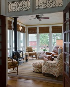 Traditional Living Room with Wall sconce, Java Vintage Bamboo 74-inch Length Shade, Transom window, Hardwood floors