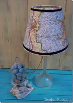 map lampshade. idea for the spare bedroom lamp, but maybe with sepia-toned maps.
