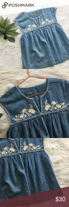 Gap Embroidered Babydoll Chambray Top Gap embroidered babydoll top size small. 23 inches long, 17 inch bust. Cotton. No stains or holes, smoke and pet free home! Offers welcomed! GAP Tops Blouses