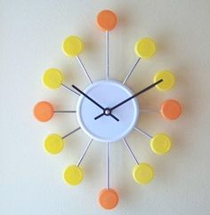 Clock from bottle/jar caps and bicycle spokes