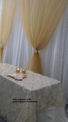 soft organza in front of the gold backdrop