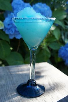 Blue Parrot ~ Tequila, Triple Sec, Blue Curacao, Lime Juice, Sugar, Ice, salt and lime wedge