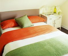 Sherbet Twist  Sherbet hues get a modern update for a dessert inspired bedroom. Sugary white bedding is accented with strong orange and key lime green linens. The sweet room is topped off with lemon walls and accessories.