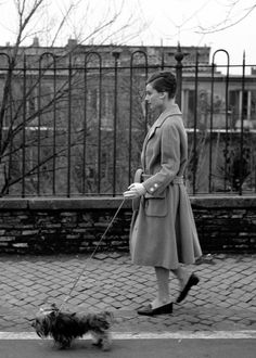 Audrey Hepburn photographed by Elio Sorci walking her dog, Mr. Famous, in Rome, October 1959.