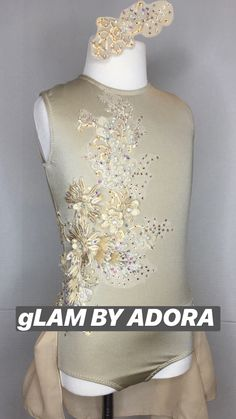 Shine brightly on stage in the stunning gold costume with half skirt. Child Medium. Custom dance costumes by gLAM by Adora.