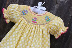 Smocked Easter Egg Yellow Polka Dot Bishop Dress from Smocked Auctions