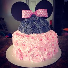 My baby shower cake I made. Minnie Mouse 3 tier cake. 2-9in rounds 1-dome cake  Whip cream pipped roses  Edible pink pearls Card stock ears And bow