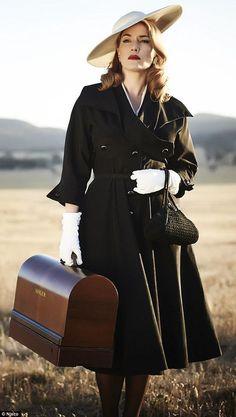 Kate Winslet in a Margot Wilson travelling coat and white gloves for 'The Dressmaker' (2015)