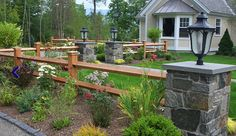 Stone posts and wood fence. Imagine adding sleeker posts and trellis' in the yard for asthetics.  https://www.merchantsmetals.com/home-business-owners/#mpf-popup@https://www.merchantsmetals.com/wp-content/uploads/2014/06/Landscaping-with-Wood-Fence-and-Stone-Posts.jpg|7961|5359b2e773537