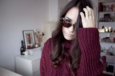 Nisi is wearing a turtle neck knit sweater and leopard / tortoise shell cat eye sunglasses from Ralph Lauren - teetharejade.com