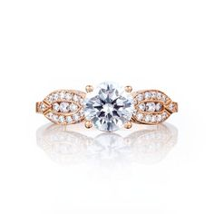 As unique as it is beautiful, this rose gold diamond engagement ring will be the center of everyone's attention. Almond shaped crescents with pavé set diamonds illuminate the round center diamond, the symbol of your promise of love.