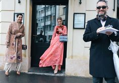 Chrisa Pappas Sioukas (left) in a Valentino coat, Charlotte Groeneveld in Valentino (center) and Dean Sioukas (right)