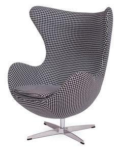 Designerski fotel EGG TETRIS      Designerski fotel wzorowany na słynnym projekcie EGG. Do jego produkcji użyto wysokiej jakości wełny oraz stali polerowanej na wysoki połysk. Obracany i bujany.