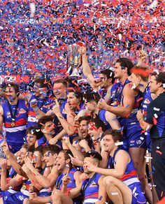 The Western Bulldogs pose with the Premiership Cup after winning the 2016 AFL Grand Final match between the Sydney Swans and the Western Bulldogs at...