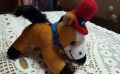 Four and a half inch stuffed horse Red Hat blue scarf