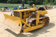 Caterpillar D2 bulldozer -Left behind our restaurant during construction in 1972, I had to try it out on the back lot. Great Fun moving dirt from here to there.  Google Search