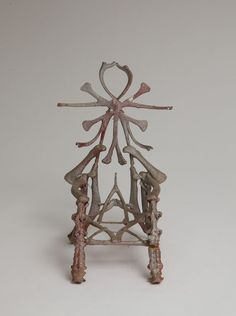 """""""Chicken Bone Throne,"""" Eugene Von Bruenchenhein, Date unknown. Chicken bones; silver spray paint over pink and red paint; wire armature; glue. Top of seat back made of rib bones; armrests of wing bones; front legs of vertebrae, 7 1/2 × 4 × 4 1/4 inches (19.1 × 10.2 × 10.8 cm) The Jill and Sheldon Bonovitz Collection, Photography by Will Brown"""