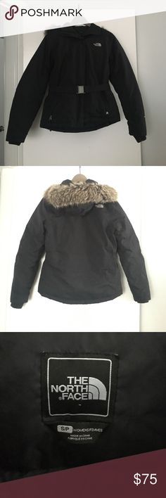 The North Face Women's Greenland Parka (Hyvent) Used but in great condition. Very warm, stylish jacket in black with waist belt; size small. Two zipped hand pockets and a zipped internal pocket with headphone slit. Waterproof and breathable. Fleece inner cuffs at sleeve. Removable hoodie with faux fur trim. Some fuzzes in velcro patch and one of the zipper was replaced (pictured). The North Face Jackets & Coats Puffers