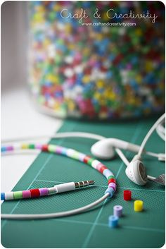 I am in love with this fun idea for decorating your earphones.  Craft and Creativity has a tutorial for using small plastic kids craft beads to add color to your earbuds.  You could do a fun arrangement of red, green and white for the holidays, or just use your favorite colors to brighten them up.