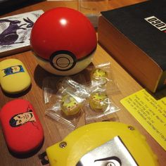 Finally got around to opening the #PokéBall I bought in Japan. It contains tasty #pikachu lollies! I am currently reading #NoLogo by #NaomiKlein and that's my library ticket for #Maus both of which very good reads. We are also getting new curtains hence the tape measure. Shoutout to @dfrxx for the #Superman and #Batman erasers and test tube container. The hare coaster was originally designed by #WilliamDeMorgan for #WilliamMorris #MorrisAndCo.