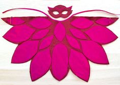 Little Owlette costume from PJ Masks for your little girl. The burgundy colored cape features magenta colored pattern just as well as the mask does. Magenta and rose pink and red and baby pink color combinations are also available. This adorable owlette costume is made of wool blend felt that I hand cut and machine stitched. The wings can be secured comfortably and easily onto the lower arms with elastic bands and with a ribbon, in matching color, around the neck. SIZES SMALL - fits…