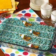 Lanes of swimmers race for the finish line during the Olympics and your guests will race to enjoy these Rice Krispies Treats® decorated like a racing pool.