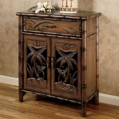 The Tropical Palm Tree Storage Cabinet features designs of palm trees and exotic leaves. Perfect in any setting, this wooden accent cabinet, with a honey. Tropical House Design, Tropical Home Decor, Tropical Interior, Tropical Colors, Tropical Style, Tropical Houses, Tropical Bathroom, Tropical Bedding, Palm Tree Decorations