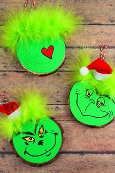 holiday crafts These Wood Slice Grinch Ornaments are a fun and festive holiday craft that make for great gifts and look great on a Christmas tree. We had so much fun making these Grinch inspired Christmas ornaments! Grinch Christmas Decorations, Grinch Christmas Party, Grinch Ornaments, Wood Ornaments, Ornament Crafts, Christmas Wood, Diy Christmas Ornaments, Homemade Christmas, Christmas Projects